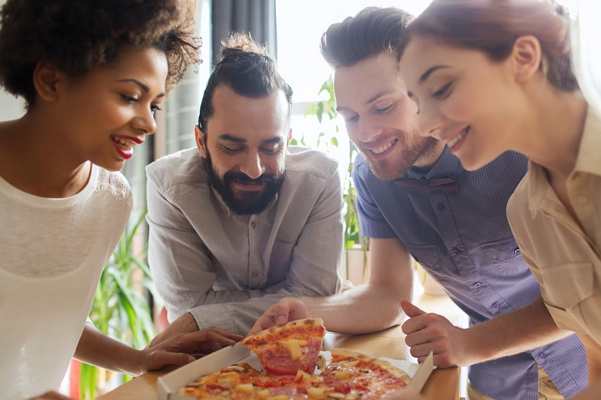 friends sharing pizza